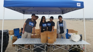 Andrea and Myriella help staff the supply tent along with other Beach Captains