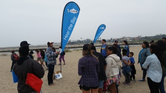 A Heal the Bay Speaker's Bureau volunteer gives an educational safety talk to a group of cleanup volunteers